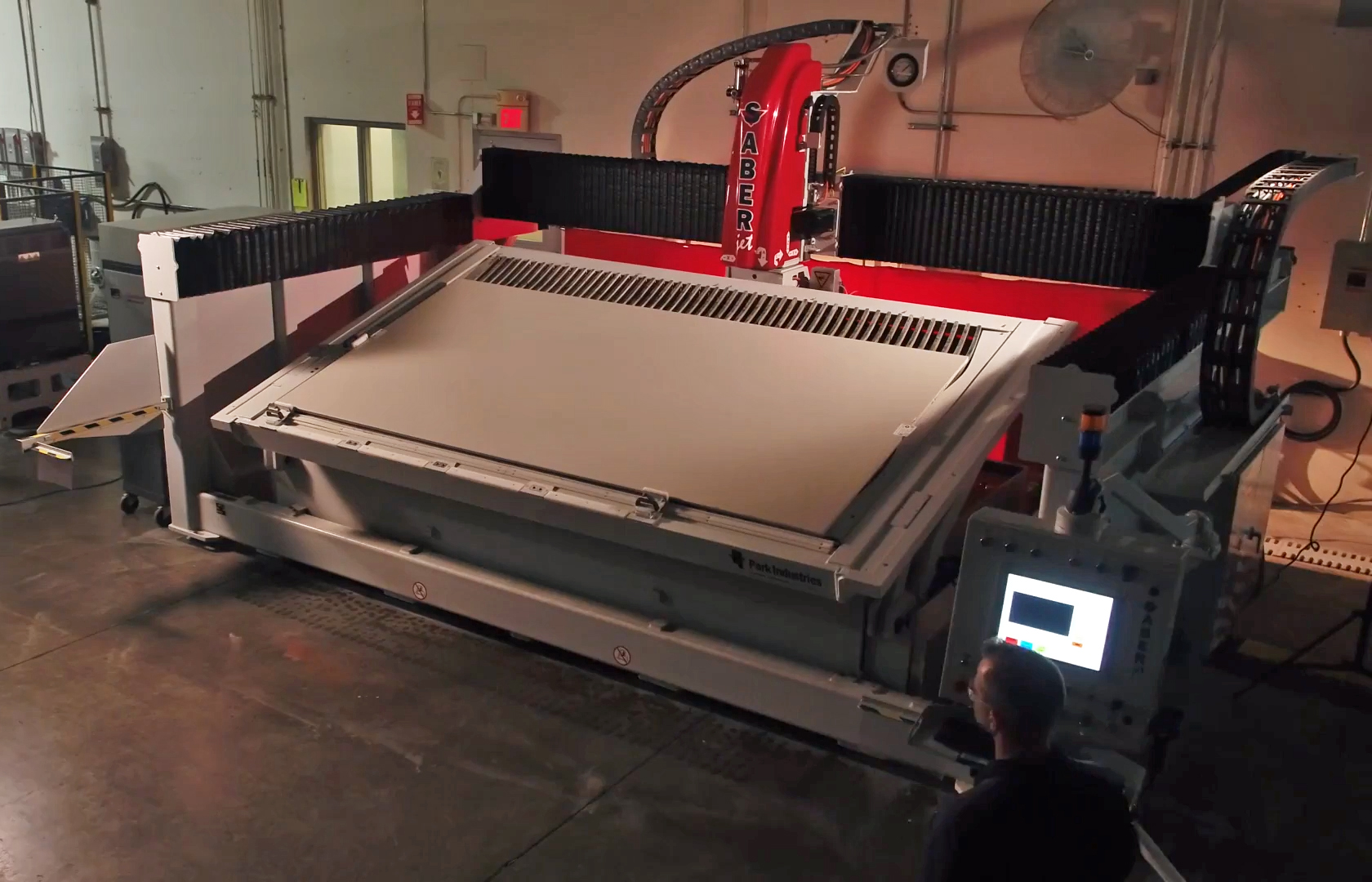 SABERjet CNC sawjet with slab loading tank for stone countertop fabrication