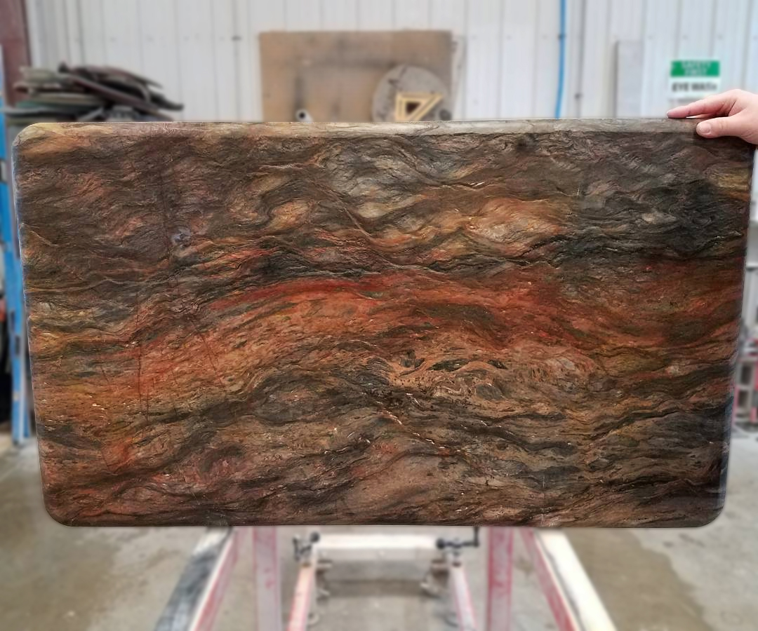 TITAN CNC Router leathered finish stone piece by Earth Elements Design Center